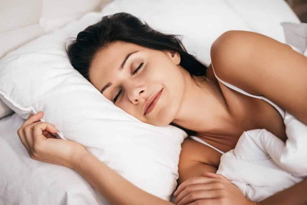 Women Sleeping after installing Night Guard