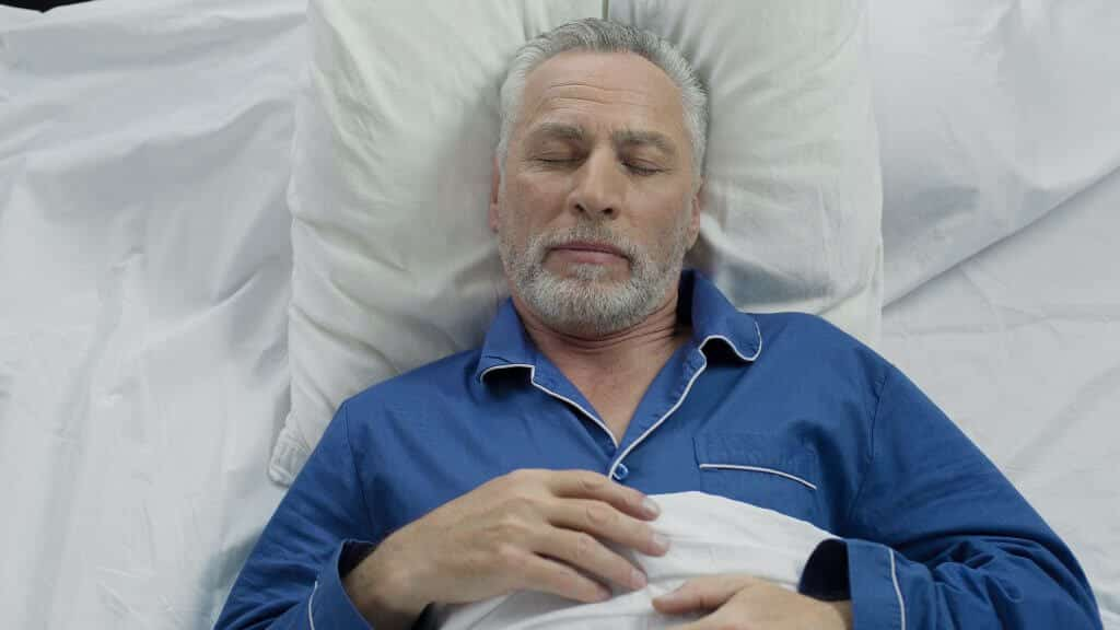 Old Man Sleeping Peacefully after Sleep Apnea Treatment